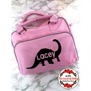 dinosaur changing bag pink